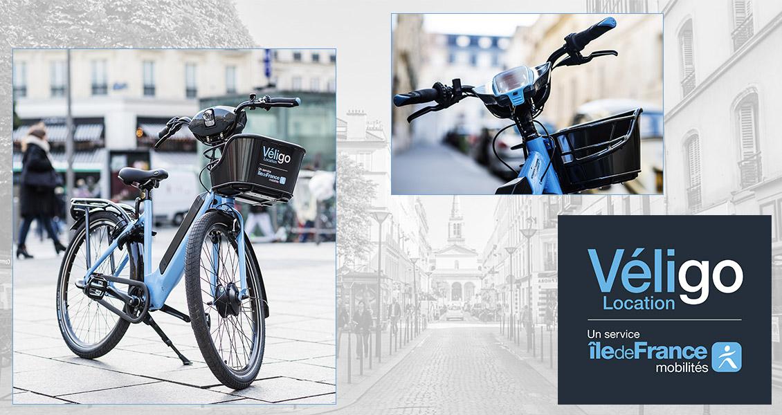 Montage avec le vélo électrique Véligo, un focus sur l'avant du cadre (guidon et panier) et le logo Véligo Location.