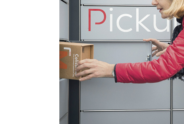 Photo of a Pickup locker from which a woman is collecting a Colissimo.
