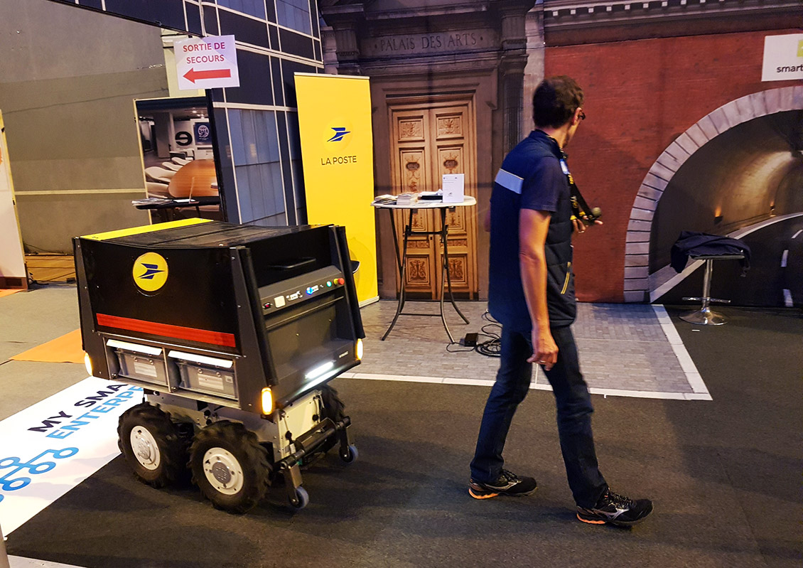 "The now famous ""robotic trolley"", designed to make postal  deliveries easier in city centres, could be seen wondering around the show."